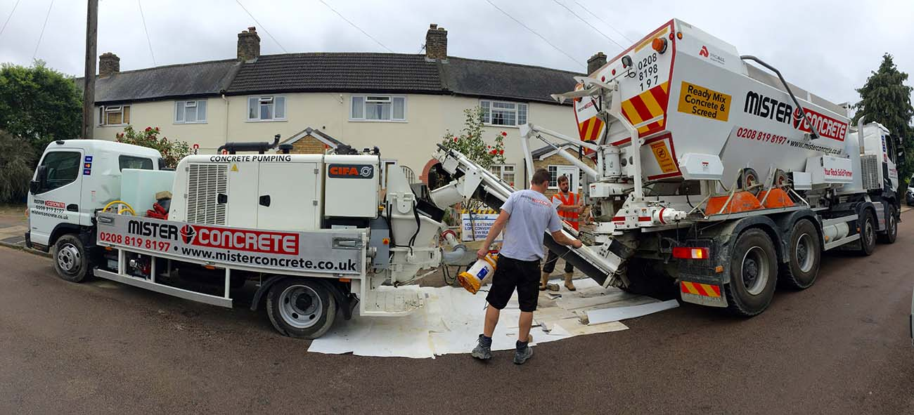 concrete pump and truck being cleaned